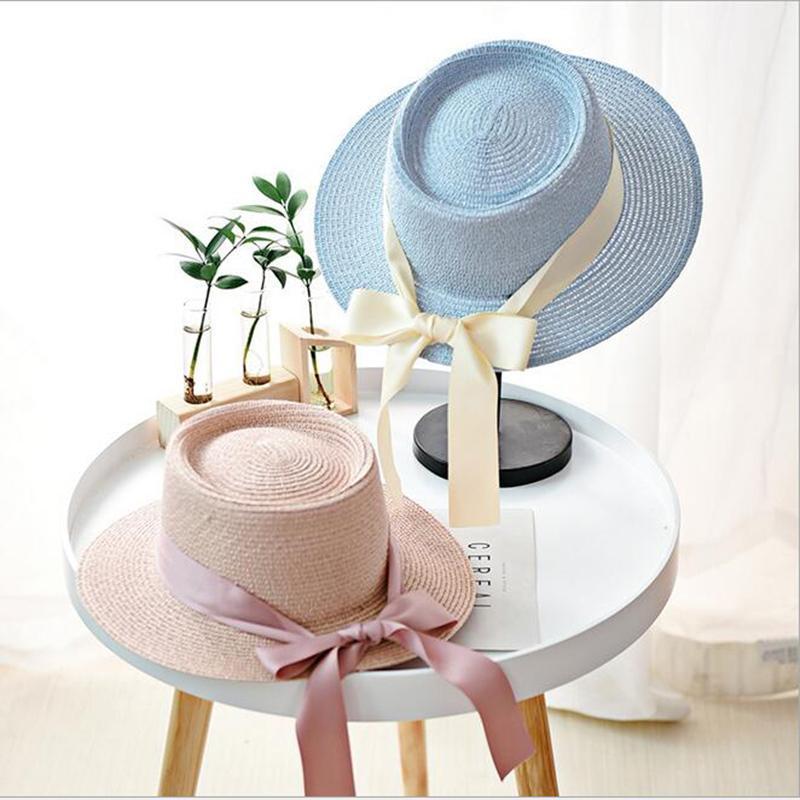 21b0aabf3b799 Women Summer Beach Sun Cap 2019 New Brand Flat Top Straw Hat Fashion Girl  Ribbon Bow Beach Hat Boater Hats Bone Feminino