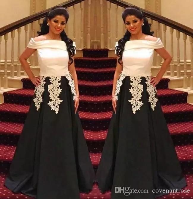 253d9d1294 Compre 2019 Saudi Arabic A Line Vestidos De Fiesta En Blanco Y Negro Fuera  Del Hombro Apliques De Encaje Vestidos De Noche Vestido De Fiesta Formal De  Satén ...