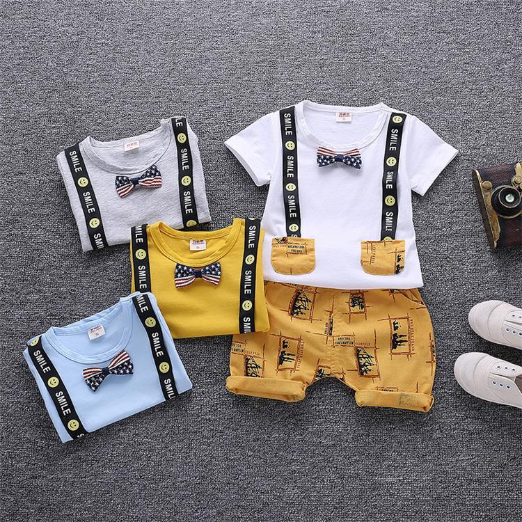4fd76daa7a96 Ropa para niños 4 colores Camiseta de verano Pantalones cortos Conjuntos de  2 piezas Ropa de diseñador para niños Camiseta de dibujos animados de ...