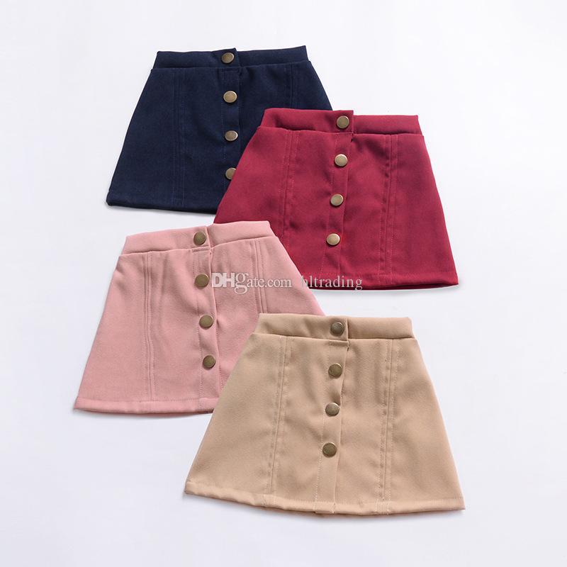 6318009fd INS niñas de bebé de Un solo pecho faldas de color Sólido niños falda con  botones 2019 Boutique de moda de verano para niños Ropa C5851