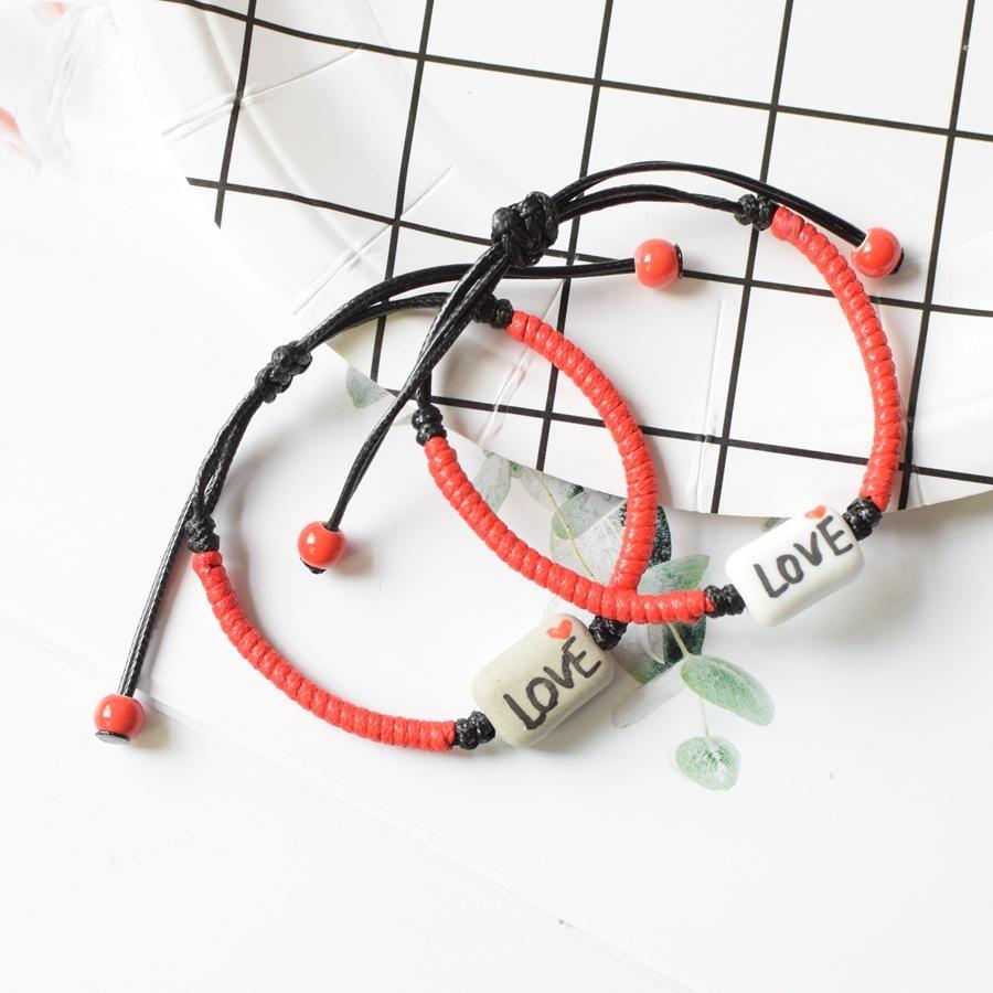 d637c2d7c731 Compre Pareja Pulsera Cuerda Roja Modelos De Explosión Joyería Cerámica  Señoras Pulsera Amor Pulseras Sacudiendo Sonido Con El Mismo Párrafo A   2.24 Del ...