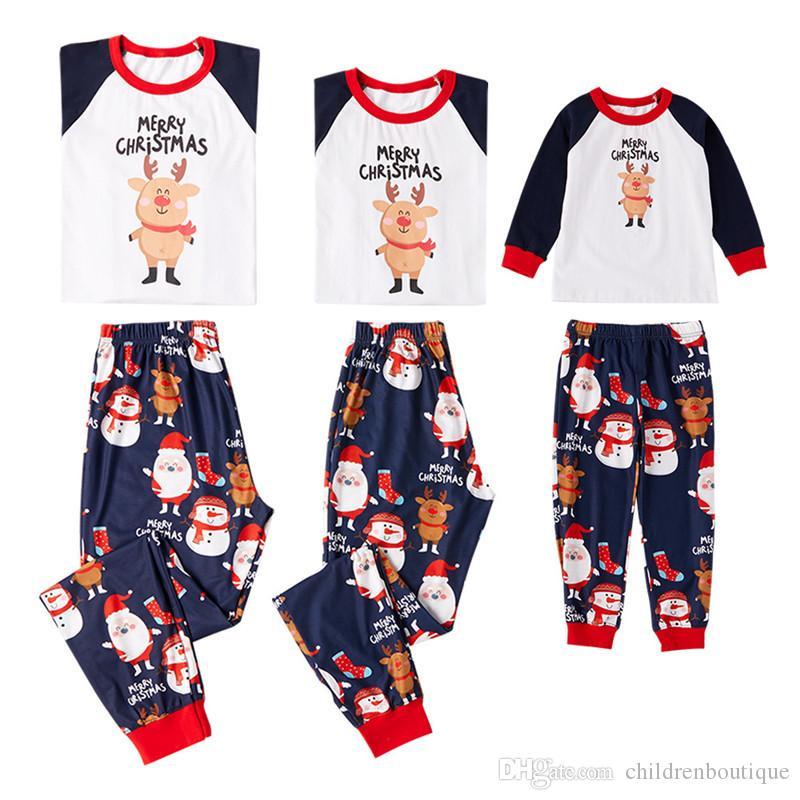 4be633fb9c Compre Familia Navidad Pijamas 2019 Familia Trajes A Juego Madre Padre  Niños Ropa Conjuntos Dibujos Animados Navidad Cerdo Impreso Pijamas Ropa De  Dormir ...