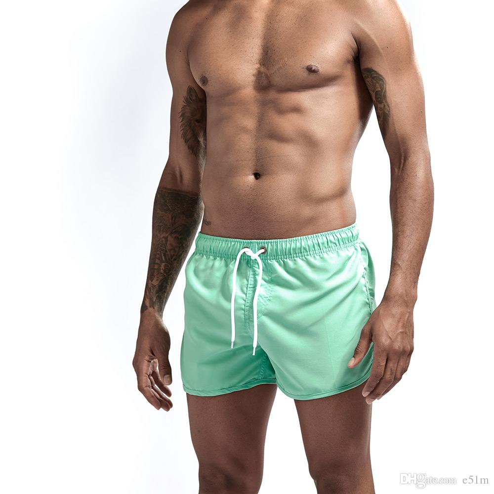 30a9cd9090 2019 Mens Swimwear Sexy Board Shorts Beach Surfing Sweat No Mesh Liner  Swimsuits Bathing Suits Plavky Solid Colors From E51m, $6.1 | DHgate.Com
