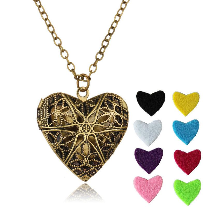 "Heart Pendant Aromatherapy Necklace Fashion Jewelry Hollow Charms Necklaces With 8 Pcs Color Refill Pads and 23.62"" Adjustable Chian B388Q F"
