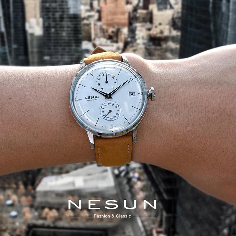 74d71316ce6 Compre Nesun Marca De Lujo De Los Hombres Reloj Mecánico Automático De Los Hombres  De Moda Relojes De Pulsera De Cuero Genuino Reloj Masculino Relogio ...