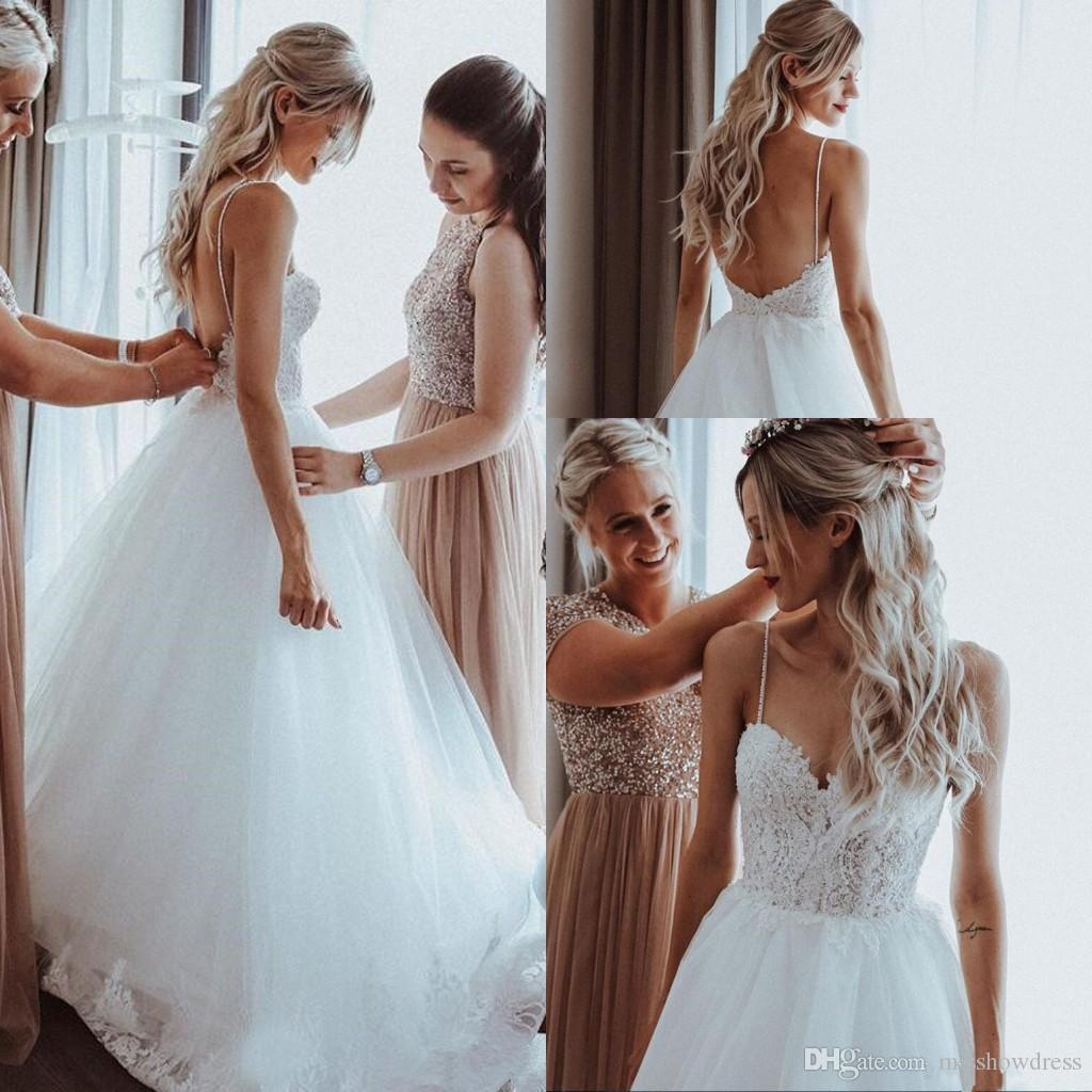 2019 Summer Beach Wedding Dresses Spaghetti Straps Tulle Lace Applique Beaded Backless Court Train Garden A Line Wedding Bridal Gowns
