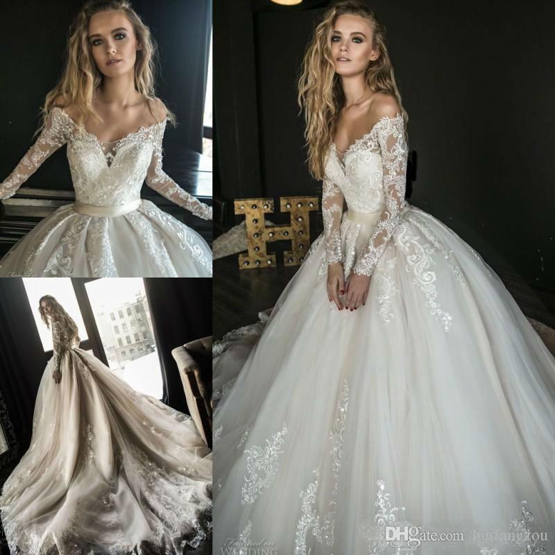 b72770f31b6 Discount 2019 New Beach Wedding Dresses Off Shoulder Long Sleeve Tulle Robe  De Mariée Lace Applique Sequined Bridal Gowns Plus Size Wedding Dress Bridal  ...