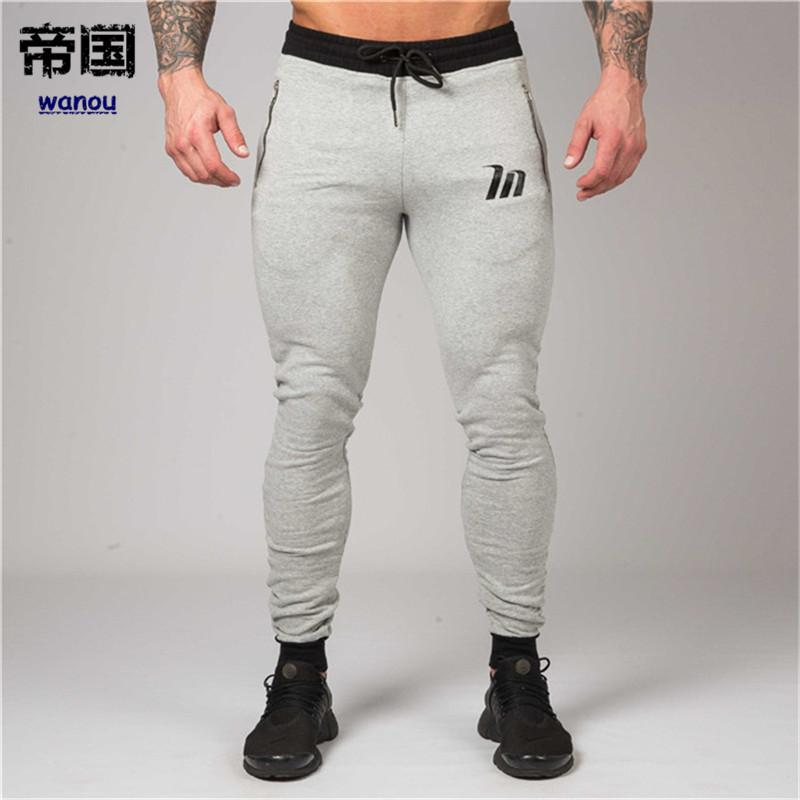 ad9a0afc69e0 2019 Jogging Pants Men Cotton Gym Sweatpants Sport Pants Men Fitness  Trousers Running Joggers Pants Sportswear Trackpants Leggings From  Diguowanou