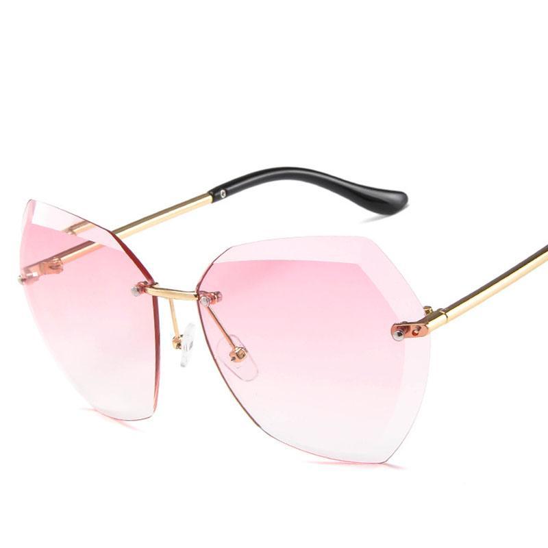 f173dbe02a Compre 2019 Moda De Lujo Sin Montura Gafas De Sol Mujeres Transparentes  Marco De Metal Transparente Gafas De Sol Vintage Hembra De Gran Tamaño Gafas  De Sol ...