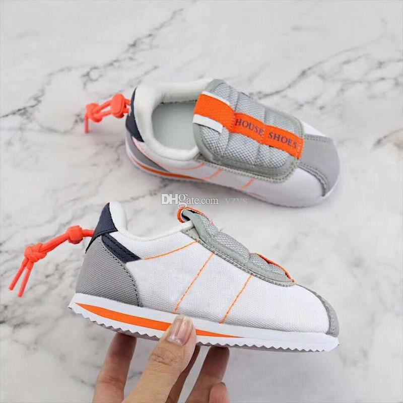 new concept ed074 eac3a Free Shipping Kids Kendrick Lamar x Cortez Basic Slip Running Shoes Youth  Boys Girls Children Infant Toddlers White Orange Sneakers For Sale