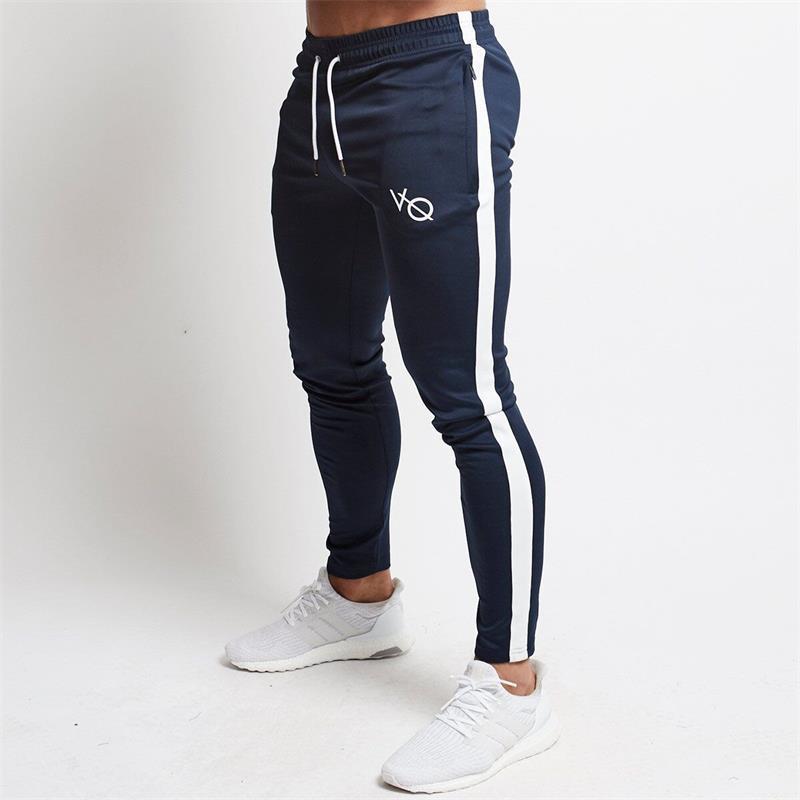 8757f1d1df1e4 Compre Pantalones Deportivos Para Hombres Banda De Jogging Pantalones  Largos Gimnasio Fútbol Pantalones De Chándal Gimnasio Entrenamiento  Pantalones Para ...