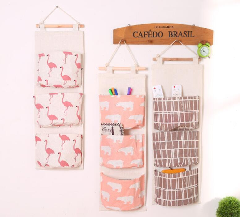 e56a931870 2019 Flamingo Pattern Cotton Linen Hanging Storage Bag 3 Pockets Wall  Mounted Wardrobe Hang Bag Wall Pouch Cosmetic Toys Organizer ANI 174 From  ...