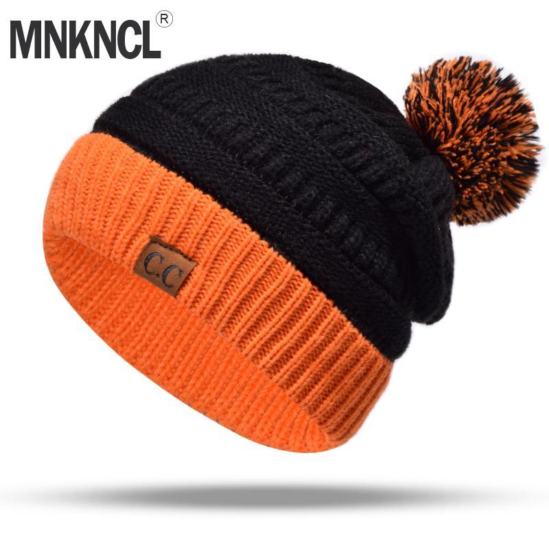 Compre MNKNCL 2018 Nuevo C.C Sombrero De Invierno Para Mujer Sombrero De  Punto De Algodón Pompones Bola Cálido Hembra Skullies Gorros Capo A  34.09  Del ... 3a51a18f04d