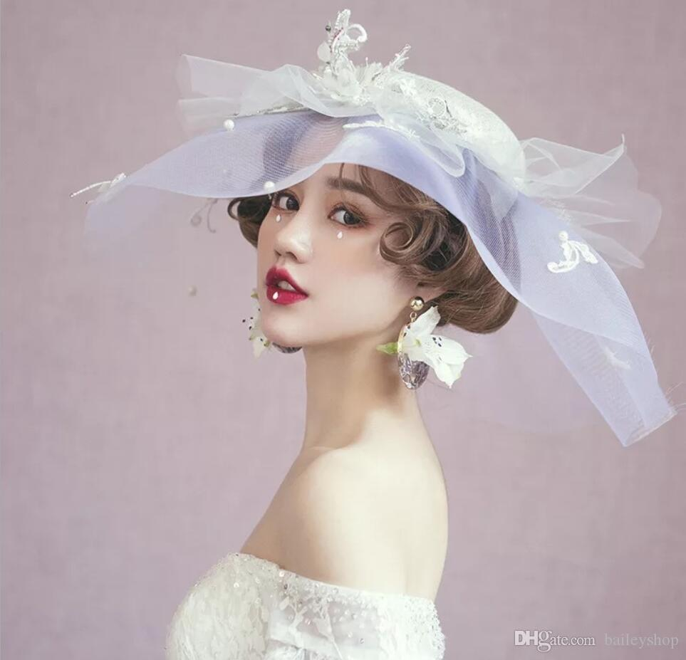 Fashion new temperament sweet and elegant cover face white silk hat when assembling the palace wind noble hat