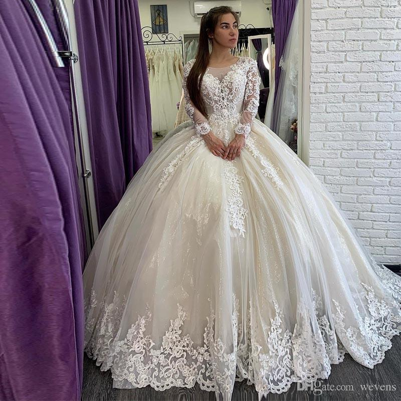 Gorgeous Arabic Dubai Lace Beaded Wedding Dresses Long Sleeves Sheer Neck Crystals Bridal Gowns Corset Back Sequined Wedding Gown