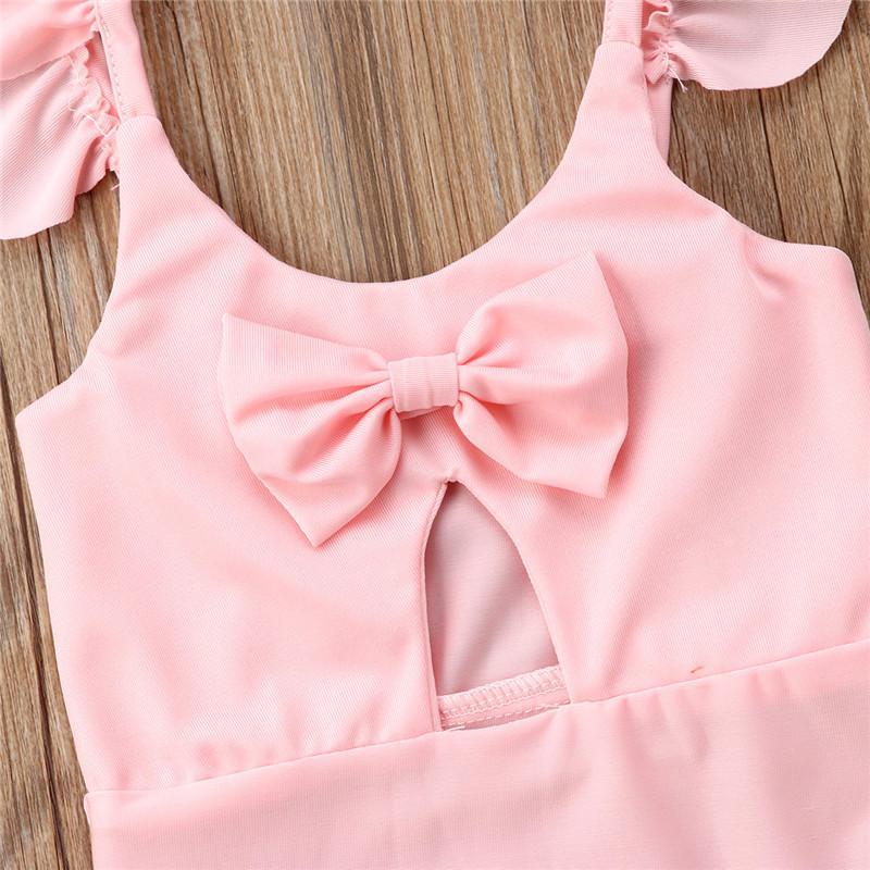 Hot sell girls pink beachwear bikinis one piece lovely kids baby Ruffles bowknot solid swimwear bathing suits children 1-6T 2018