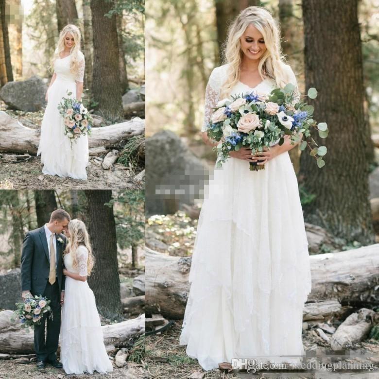 Discount Western Country Wedding Dresses Lace Chiffon Modest V Neck Half  Sleeves Long Bohemian Bridal Gowns Plus Size Robe De Mariée En Dentelle  Wedding ... ccceb49421e5
