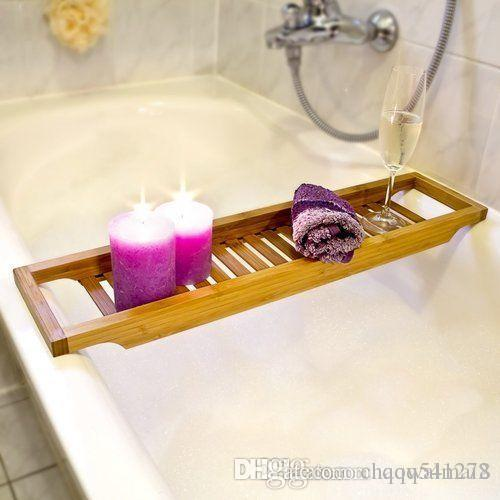 bamboo handcrafted bath tray shelves placed in the bathtub above