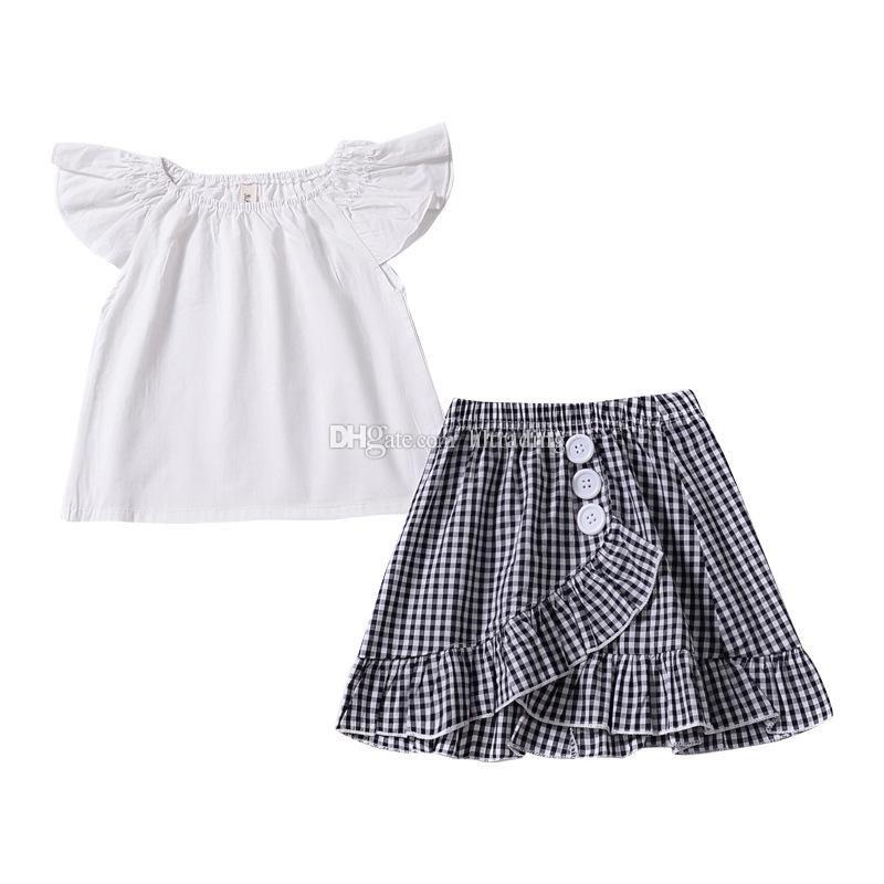 2a219ad1b INS niñas bebés trajes a cuadros niños White Flying manga superior +  celosía faldas plisadas 2 unids / set 2019 Summer Boutique niños Conjuntos  ...