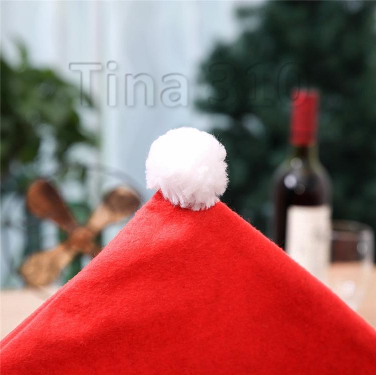 Nouvelle décoration de table de Noël chaise non-tissé ensemble dessin animé vieux tabouret de bonhomme de neige de Noël chapeau fixé T3I5377