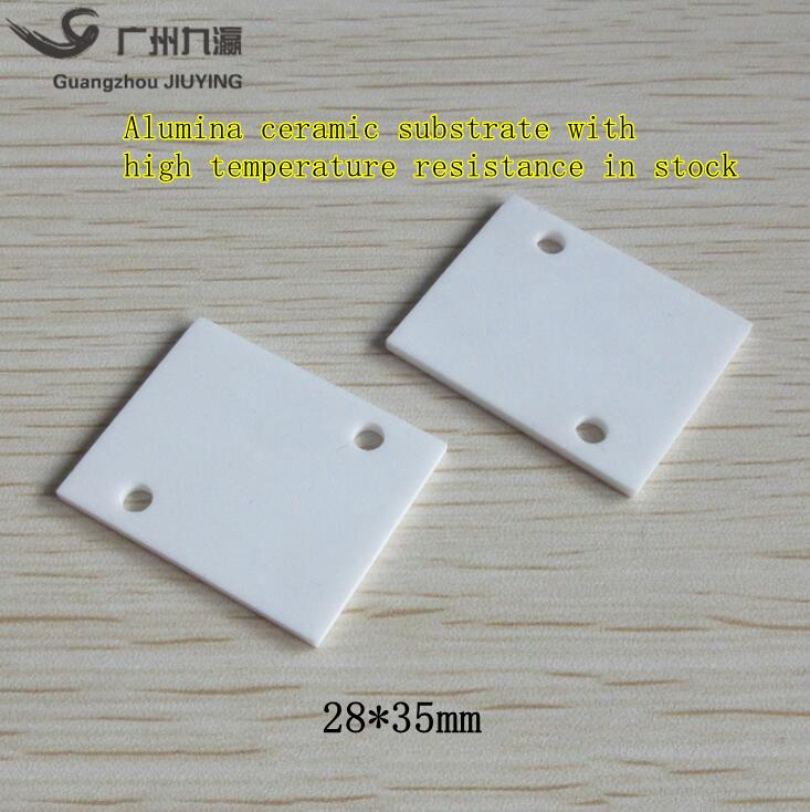 96% Aluminium oxide thermal conductive ceramic substrate 28*35*2mm double  holes with high temperature resistance and insulation