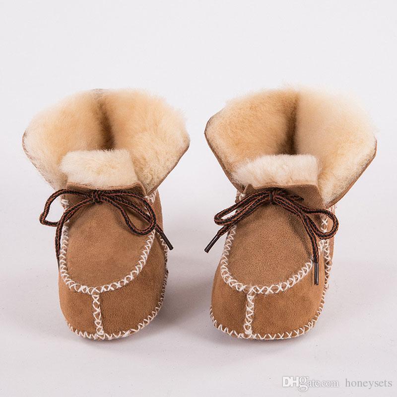 dfe6d7fc1 Compre Bebé Niños Niñas Invierno Grueso Realmente Piel De Zalea Botas  Cálidas Para La Nieve Niños Antideslizantes Prewalker Costura A Mano Zapatos  De Suela ...
