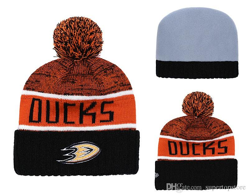 NEW Men s Anaheim Mighty Ducks Knitted Cuffed Pom Beanie Hats ... a4283422dfce