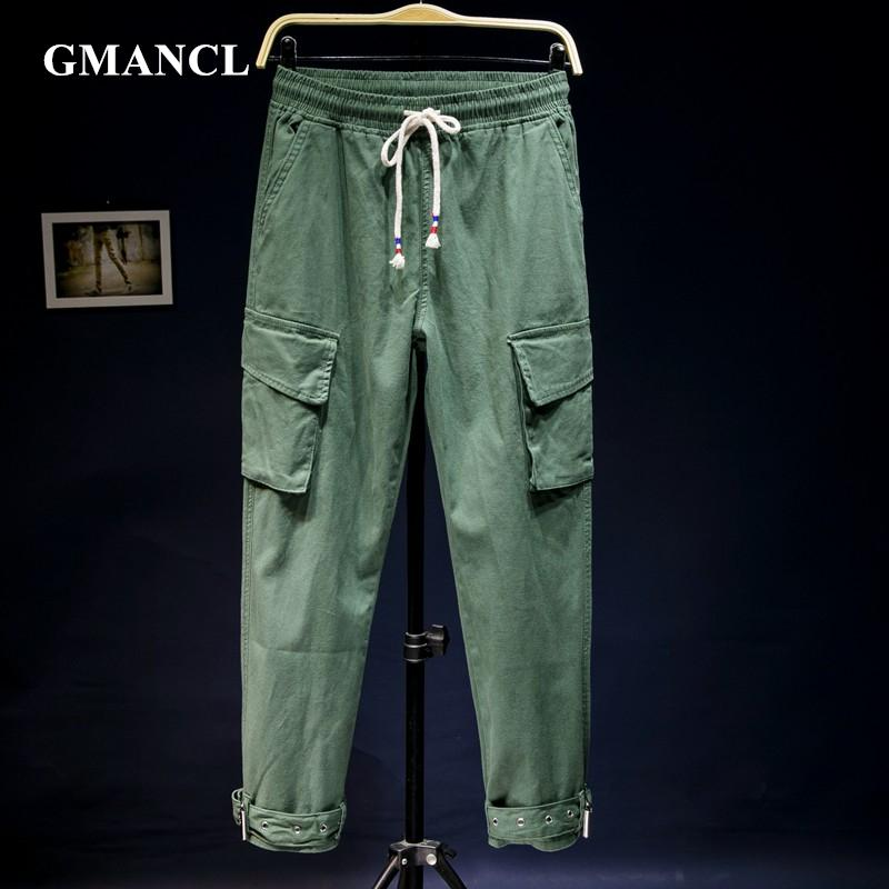 18d3836fd83 2019 Men Spring Multi Pocket Solid Loose Straight Casual Cargo Pants Jeans  Elastic Waist Drawstring Streetwear Joggers Sweatpants From Mujing