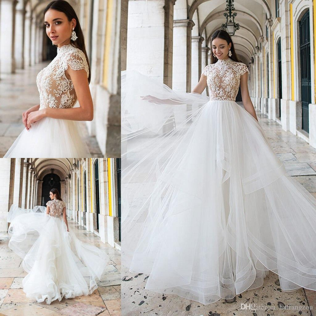 253f217cb0 Discount Oksana Mukha 2019 Beach Wedding Dresses A Line Tiered Ruffles  Short Sleeve Lace Applique Bridal Gowns High Neck Illusion Wedding Dress  Wedding ...