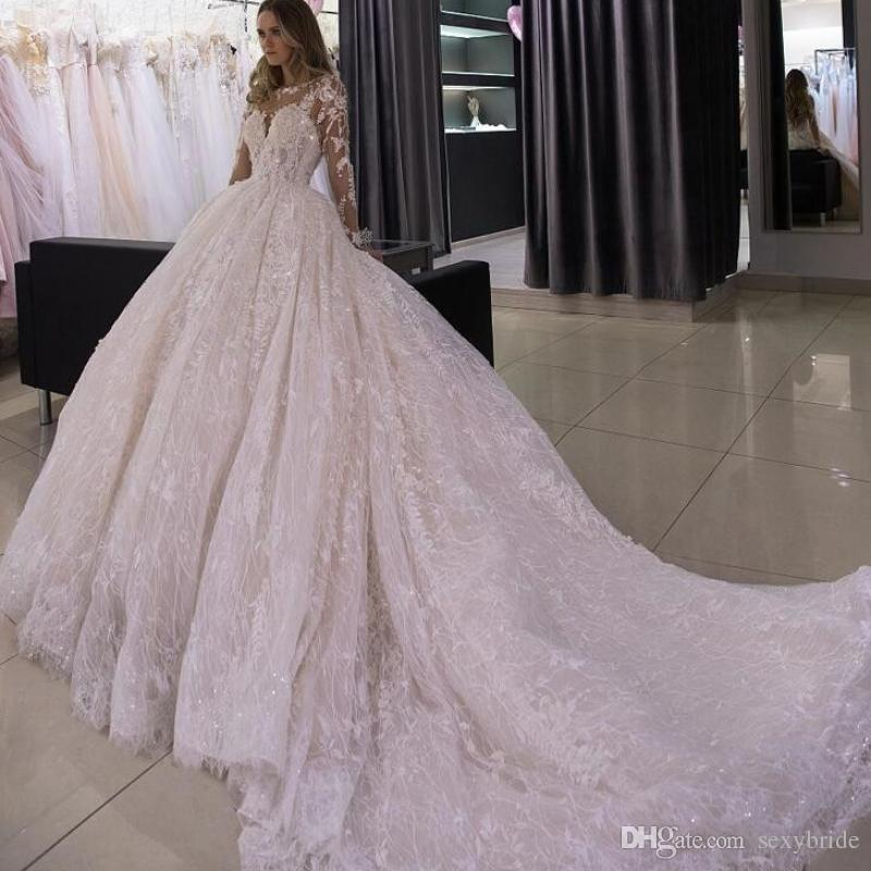 Luxurious Lace Ball Gown Wedding Dresses Cathedral Train 2019 Bling Beaded  Sheer Long Sleeves Illusion Jewel Neck Gorgeous Bridal Gowns Short Wedding  Dress ... 4ece01488f02
