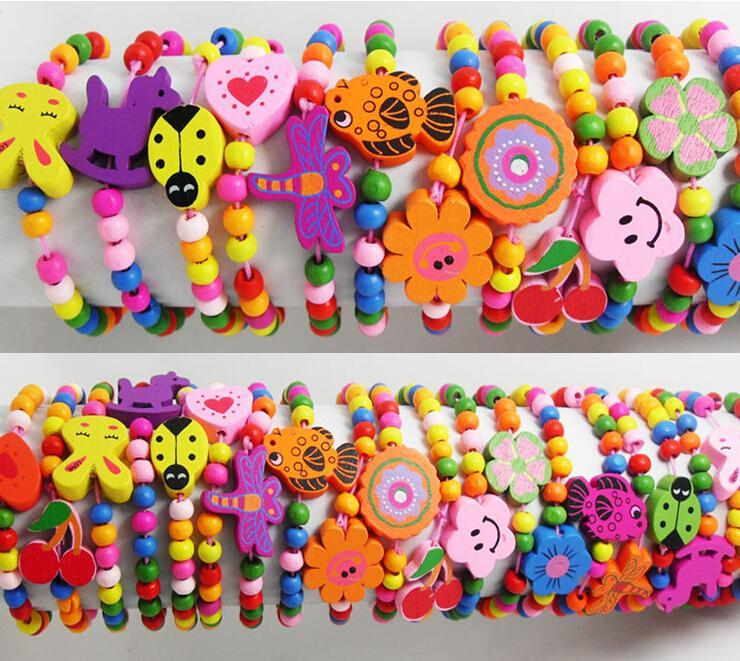 Wholesale-60pcs Kids Girls Wood Bracelets Children Wristbands 12 design Mix Wholesale Birthday Party Gift Jewelry Lot