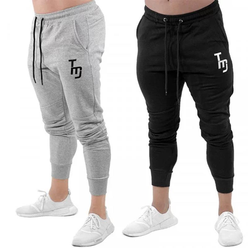 4e46b40bf 2019 Mens Athletic Fitness Joggers Designer Muscle Pencil Pants Casual Slim  Fit Sports GYM Pants From Xiamendhwholesale, $38.69 | DHgate.Com