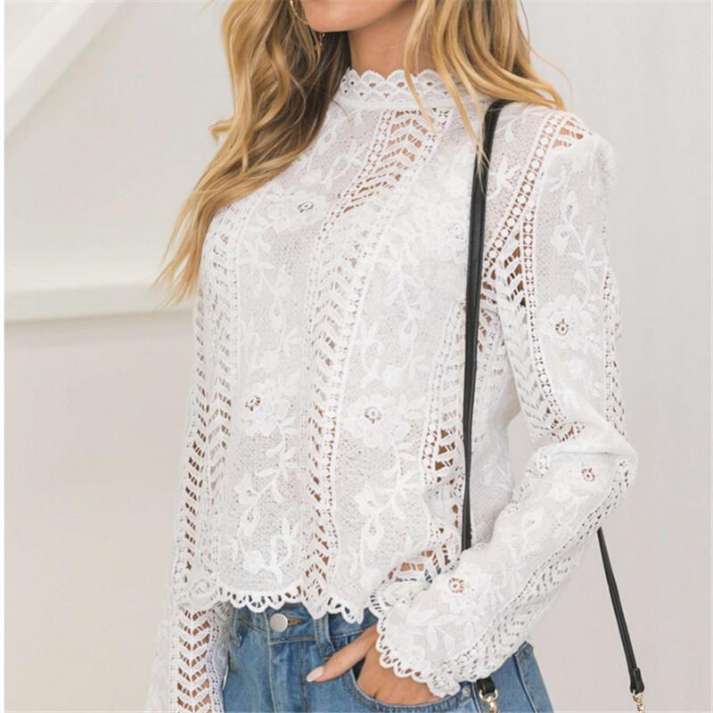 c55bb1d2eccb Volver Mujeres Encaje Blanco Hollow Blusa de manga larga de cuello alto Top  Blusas de verano para las mujeres tapa elegante blusa femenina