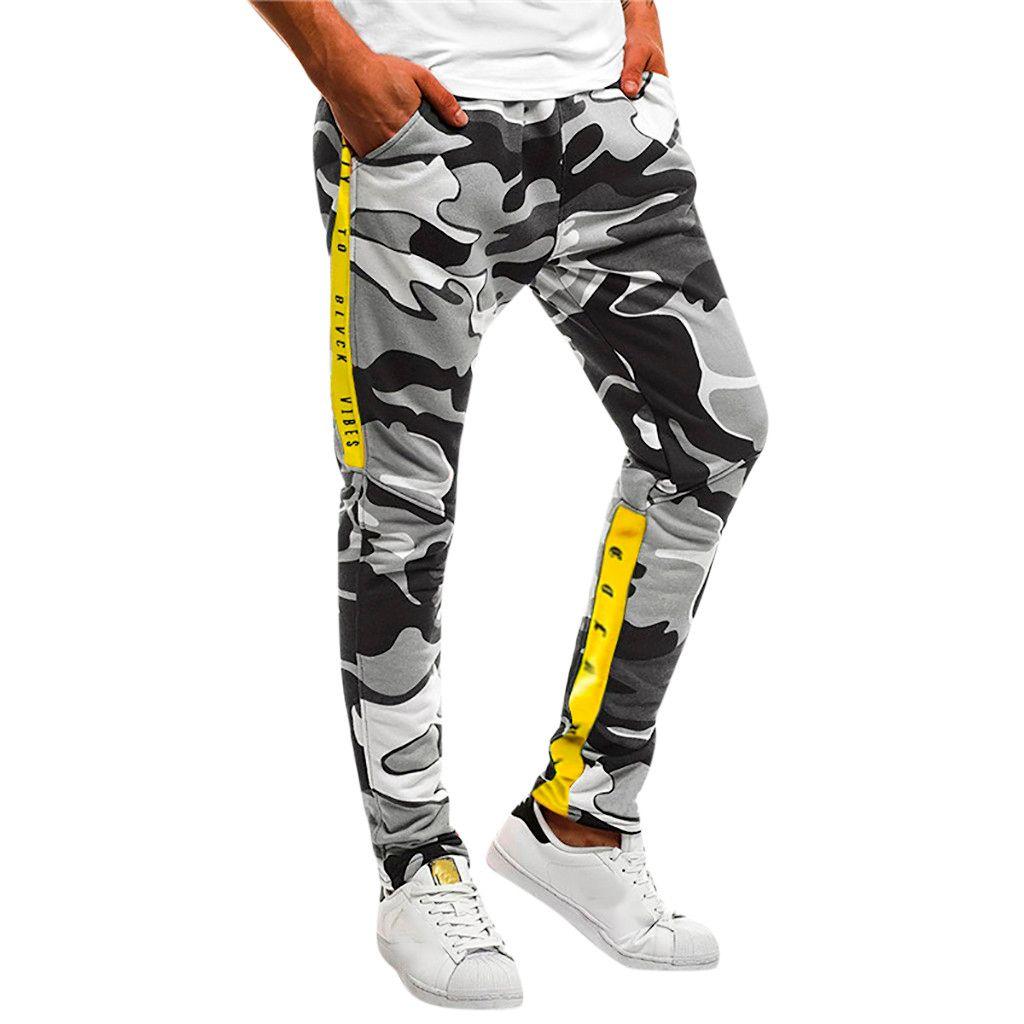 2652a29b85 Compre Pantalones Deportivos Ocasionales Pantalones De Chándal Pantalones  Sueltos De Bolsillo Ropa De Fitness Hombres Hip Pop Pantalones Pantalon  Chandal ...