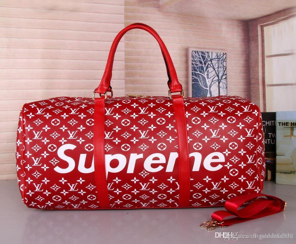 Wholesale Hot Luxury Brand Men Women Travel Bag PU Leather Duffle ... 95797dd6b5