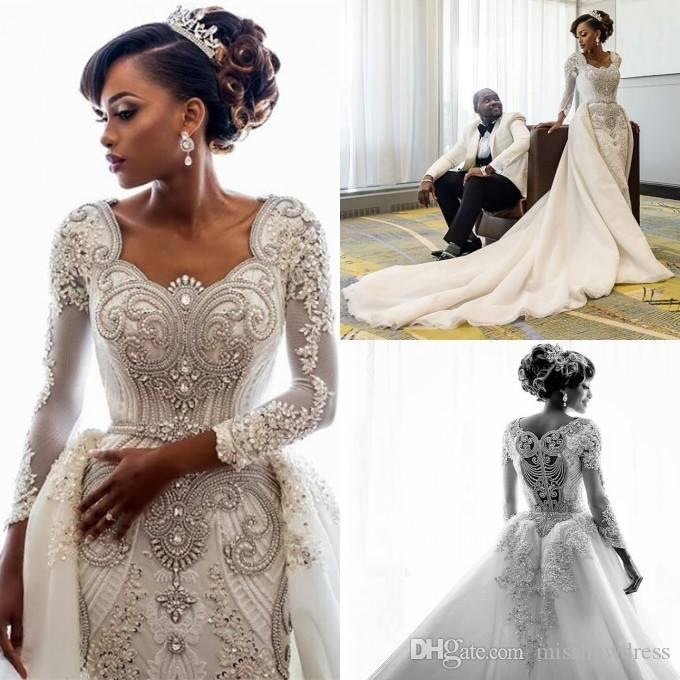 e75df4a6a64 2019 African Long Sleeves Lace Mermaid Wedding Dresses Scoop Neck Lace  Applique Beaded Crystals Over Skirts Court Train Wedding Bridal Gowns  Mermaid Wedding ...