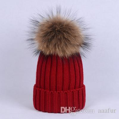 b4a804ae514 Real Raccoon Fur Pom Poms Knitted Hat Ball Beanies Winter Hat For Women  Girl  S Hat Skullies Fedora Hat From Aaafur