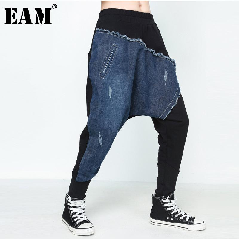 [eam] 2019 Spring New Pattern Moda Personalità Denim Stitching Elatic Vita Cross-pants Marea Pantaloni larghi da donna Yc22301 Y19071701