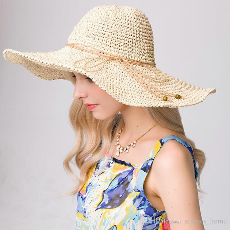 21453c2cd46 2019 New Bowknot Summer Sunhat For Women S Foldable Wide Large Brim Elegant Sun  Hat Ladies Hollow Straw Beach Caps High Quality Floppy Hats Black Floppy Hat  ...