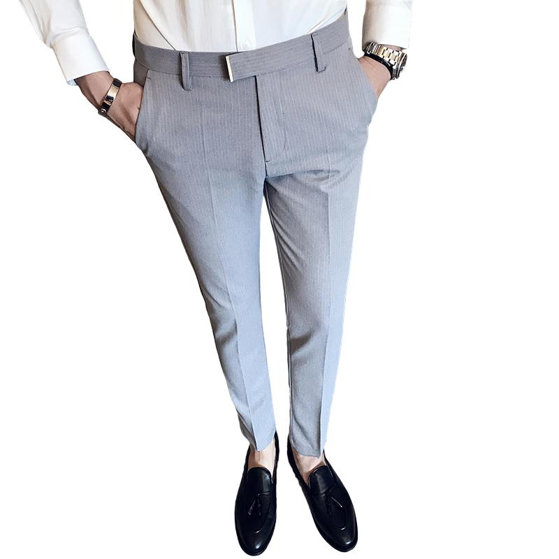 2019 new autumn and winter men's feet tapered business casual low waist pants trend slim trousers solid color striped suit pants