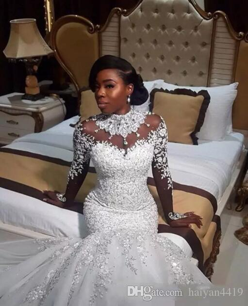 2020 New Sexy African Mermaid Wedding Dresses Illusion High Neck Long Sleeves Lace Appliques Beading Chapel Train Black Girl Bridal Gowns