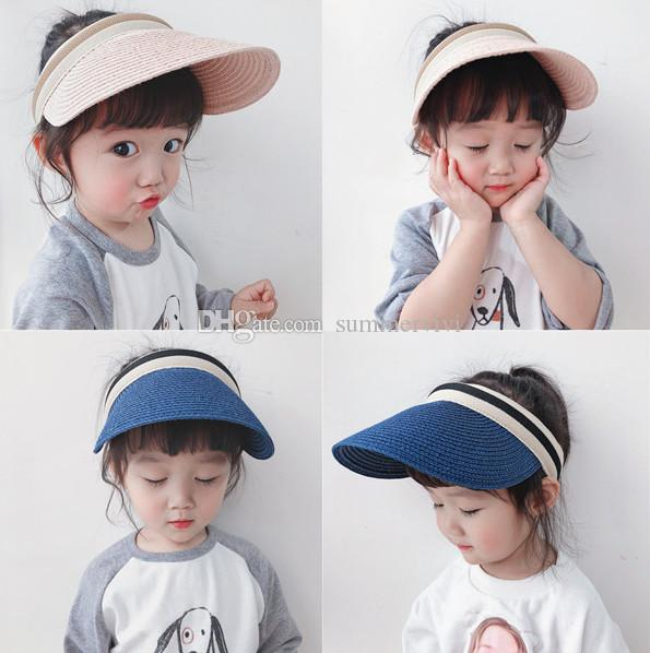 0cda52292 Children Sun hats kids grass weaving empty top hats boys strips ball cap  2019 summer new kids visor girls beach holiday shade cap F6078