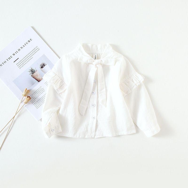 2fcc794a3 Compre Camisa Blanca Para Niñas Pequeñas 2019 Otoño Moda Bebé Niñas Blusas  Ruffles De Manga Larga Linda Tops Con Pajarita Grande Ropa Para Niños A   36.69 ...
