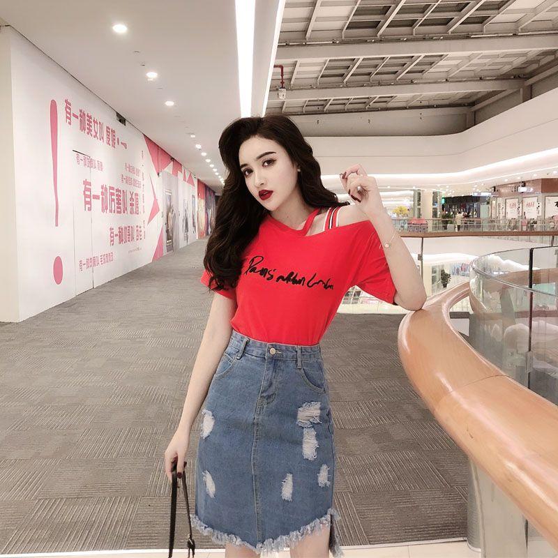 3ea5e039c 2019 ropa de mujer de verano conjunto de manga corta letras camiseta  bordada caderas delgadas borla irregular denim faldas twinset al por mayor