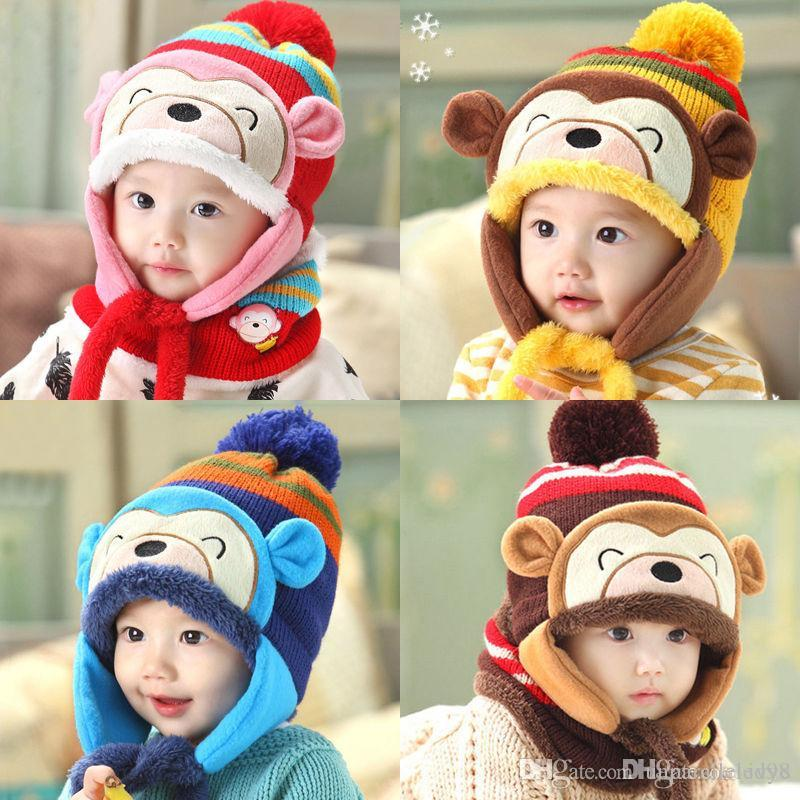 e9400143ae8 2019 Lovely Fashion Cute Kids Baby Girl Boy Winter Monkey Beanie Cartoon Hat  Earflap Knitted Warm Cap Hat From Unparalleled98
