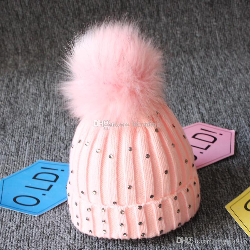 0fbcade2f8e288 2019 Baby Knitted Diamonds Hats Fur Pom Pom Bling Bling Crochet Caps ...
