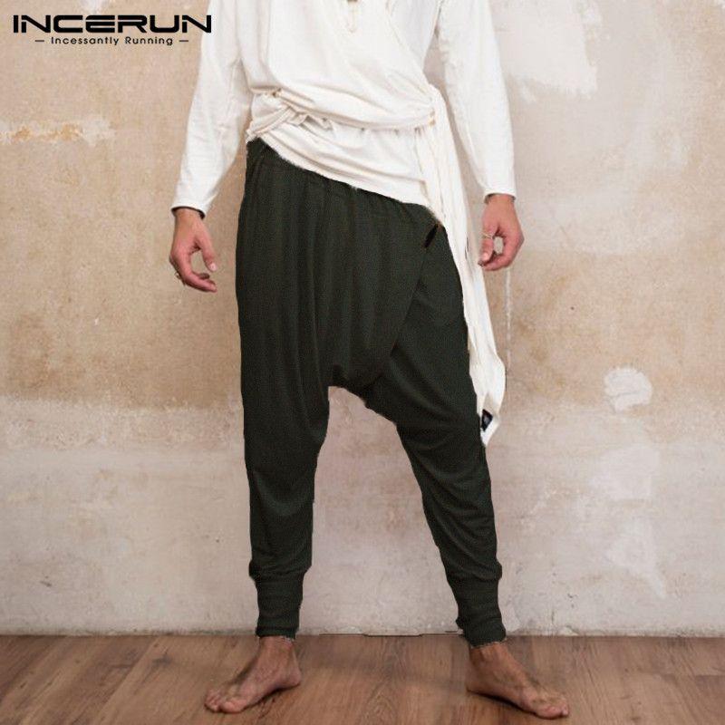0068fe39ec Pantaloni stile giapponese uomo Ninja pantaloni larghi Harem allentati  pantaloni a vita bassa con cavallo basso danza Boho moda indiana Pantalon