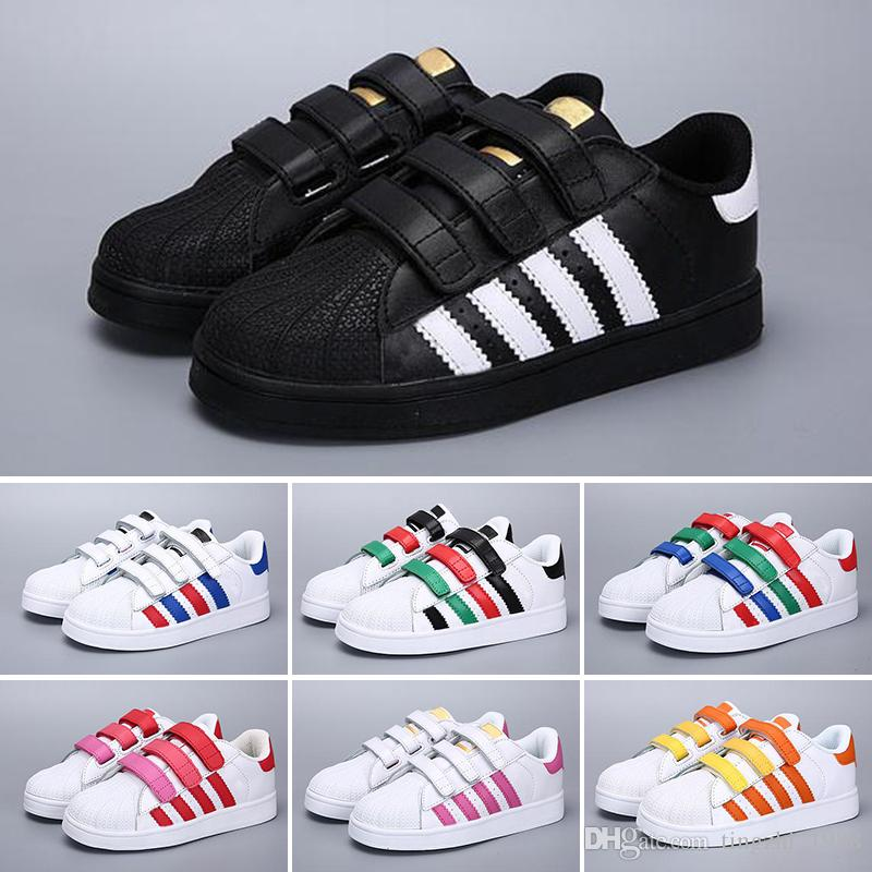 on sale 0c53b 85ced Compre Adidas Superstar 2018 Nueva Marca Shell Head Boy Chicas Sneakers  Superstar Niños Zapatos Para Niños New Stan Shoes Fashion Smith Sneakers  Zapatos ...