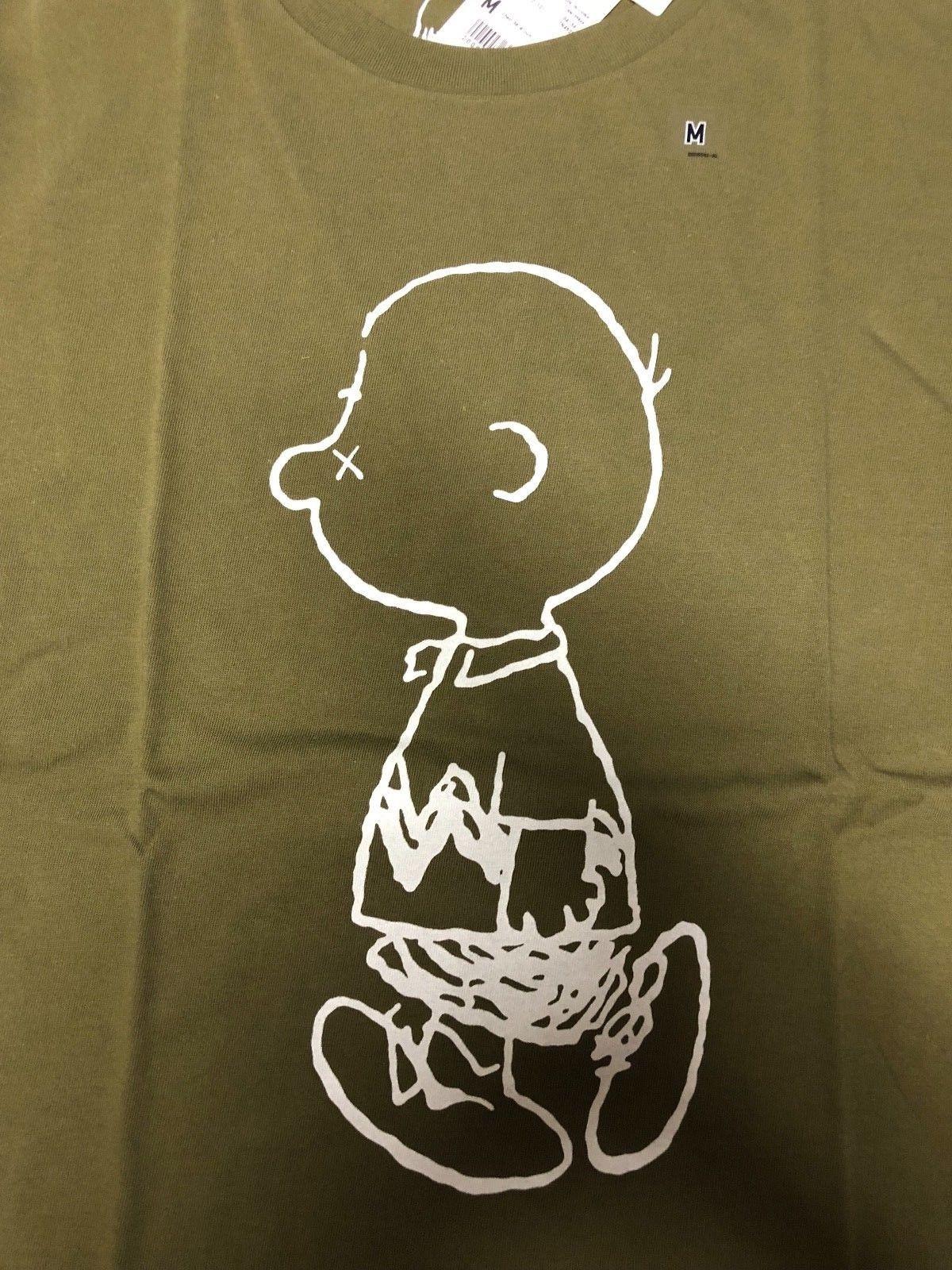 1ea8d1d9826dba Uniqlo X Kaws Peanuts Snoopy Olive Graphic T Shirt US Size M NWT Charlie  Brown Men Women Unisex Fashion Tshirt Awesome T Shirt Designs Tea Shirts  From ...