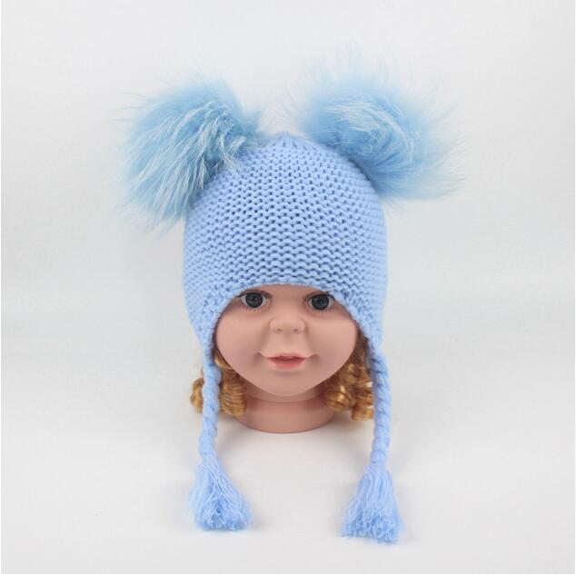 f2b473f0750 2019 Children Cute Winter Hats Two Faux Raccoon Fur Pompom Hat Baby Knitted  Cap Warm Ears Earflap Thick Kids Beanies CCA10952 From Top toy